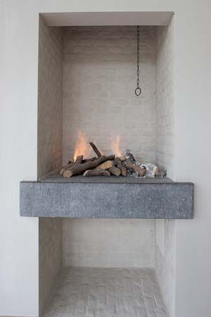 Contemporary take on a raised fireplace