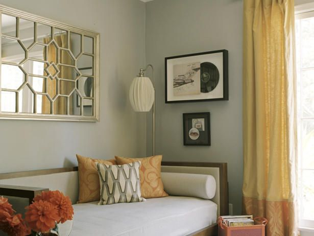 Keeping a Low Profile Daybed    Designer Erinn Valencich takes an eclectic approach to decor. She pairs a streamlined, contemporary daybed, modern, geometric mirror and pops of vibrant orange for a custom look in this cozy corner.