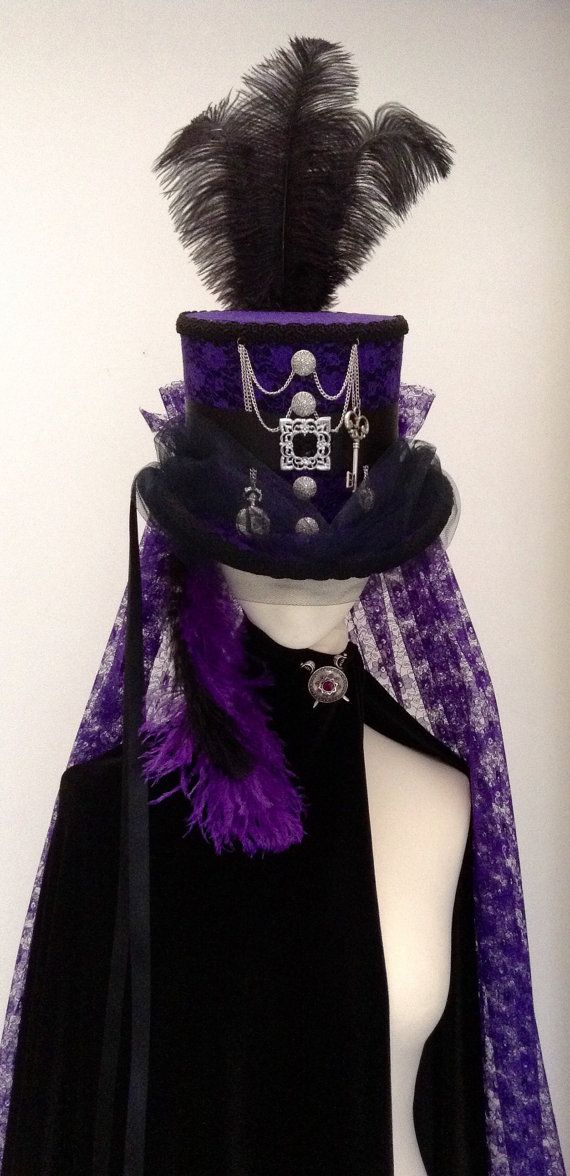 Purple lace Steampunk top hat, features include silver chains, buttons, pocket watch heart charm and key.  Face veil in black, ostrich feathers crown and dropped side and rear purple back veil at waist length, black satin ribbons side and rear.  Made in my own workshop in Scotland   https://www.etsy.com/uk/shop/Blackpin?ref=hdr_shop_menu | Shop this product here: spree.to/asxm | Shop all of our products at http://spreesy.com/JewelsByScarlett    | Pinterest selling powered by Spreesy.com