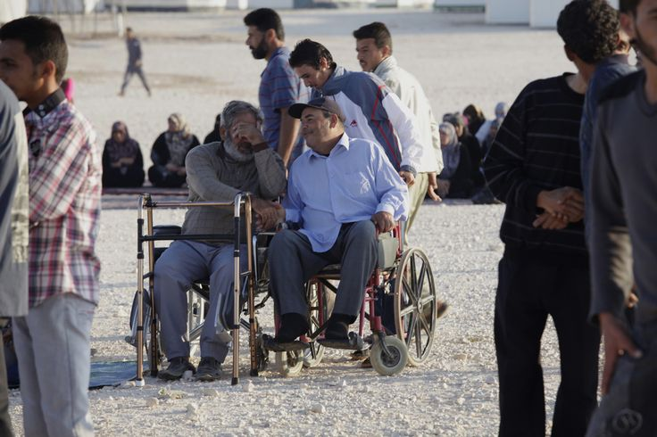 Syrian disabled refugees greet each other