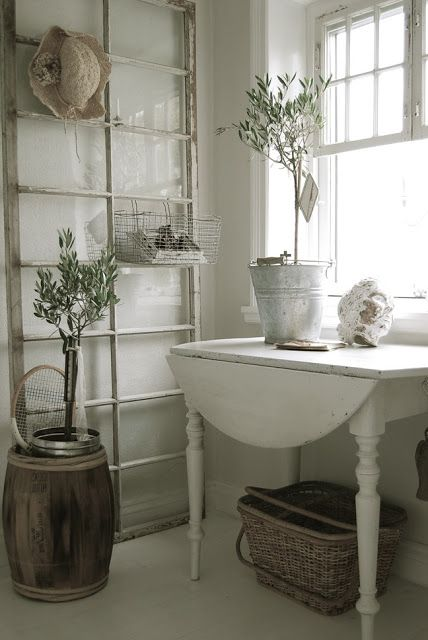 10 Unique Repurposed Windows - very cool ideas!  eclecticallyvintage.com Giant window propped against all with basket for storage.