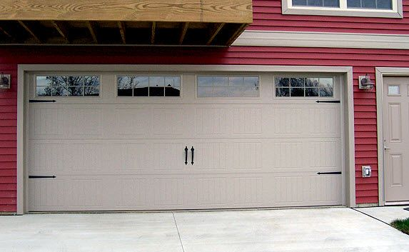Red siding with almond garage door and trim by wayne for Wayne dalton garage doors