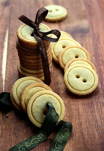 Button cookies. You need a shortbread (butter cookie) recipe, two biscuit cutters (one slightly smaller than the other), and a drinking straw (to make the holes). These are just so cute...I wonder how it would work with salt dough for Christmas ornaments???