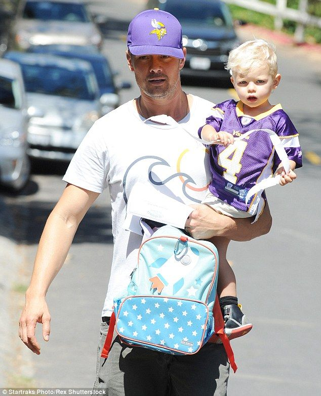Daddy day care:Josh Duhamel and son Axl wore their team's colours as they headed to an Am...
