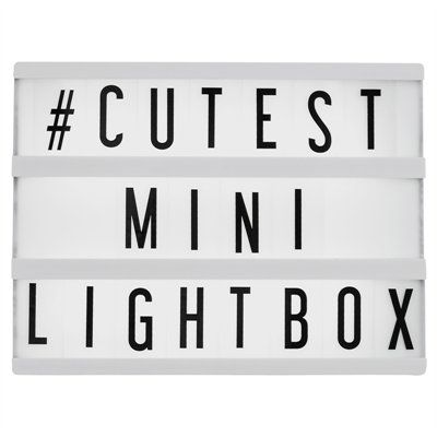 """This My Cinema Lightbox® Mini is half the size of the original My Cinema Lightbox® - and twice as cute! A perfect addition to your desk or end table, or as a unique gift for that person that has everything! Comes with 100 letters, numbers, characters and symbols + blank tiles. LED backlight. USB cable provided. Wall mounting option. 6 AA batteries required, not included. 8"""" x 6"""" x 1.5""""."""