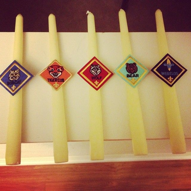 So easy! Found this idea on the front of the ceremony booklet that I got at the Boy Scout Shop! So easy and cheap to do. Candles and stands got at the dollar store and then hot glued the patches to the candles.