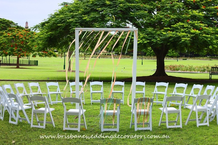 Brisbane Wedding Decorators romantic ribbon arch pictured here in our circular ceremony set up. Complimenting the couples peaches and green wedding colours xox  www.brisbaneweddingdecorators.com.au
