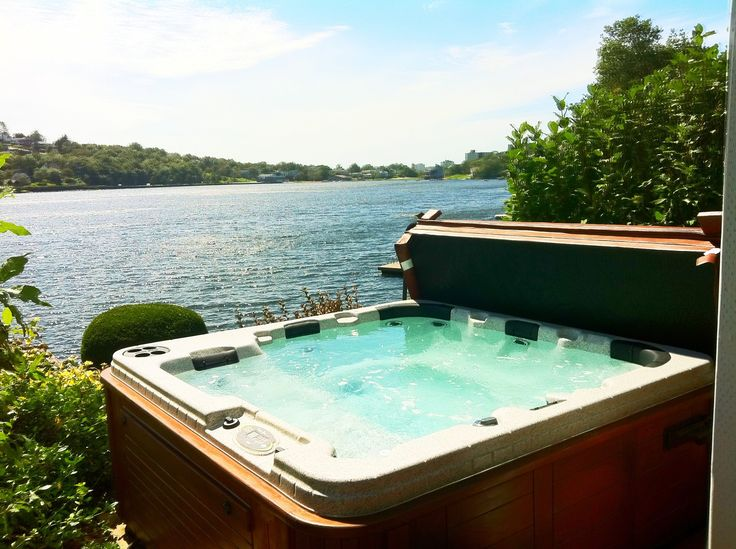 A beautiful hot tub, with a view to die for! www.sparklingpoolsandspas.ca