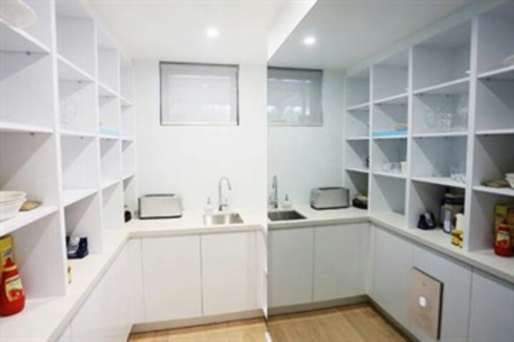 Butlers pantry. Good idea with the mirror for a small area