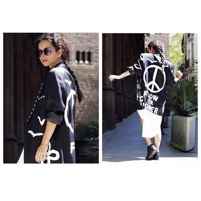 Stay free and peaceful...that's Inna's message! She loves black and white outfits!