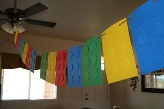 Fake out giant Legos using those foam sheets or cardstock and foam adhesive squares to make the nodes raised