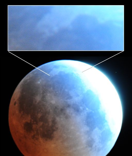 """Lunar eclipse in Colorado, 2015.04.04. A telescope shows up a blue band as the Moon emerged from totality. Light penetrating the ozone layer becomes bluer, because ozone absorbs red light. This can be seen as a turquoise-blue border around the red. (Image credit: Jimmy Westlake) Mona Evans, """"Blood Moons and Lunar Tetrads"""" http://www.bellaonline.com/articles/art301030.asp"""