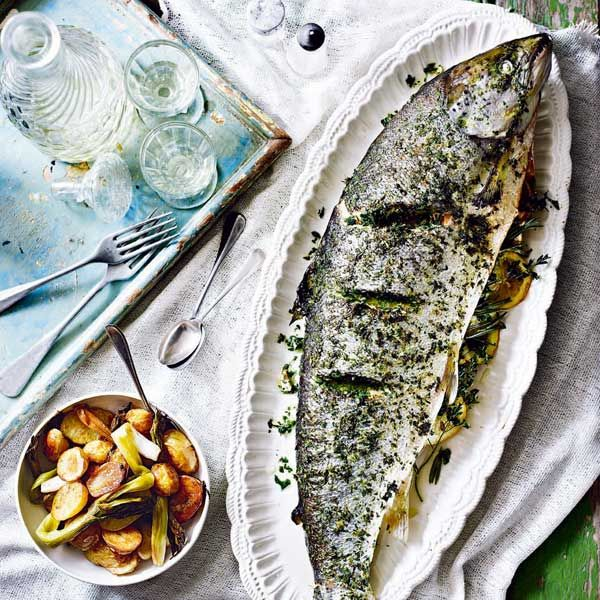 Simple to prepare, easy to cook and tastes completely summery, a whole roast salmon is a brilliant centrepiece for a group of hungry people.