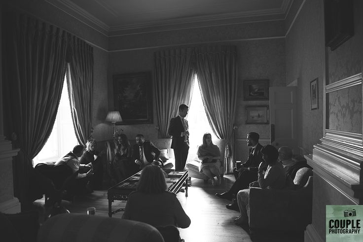 Guests chatting inside the main house. Weddings at Tankardstown House by Couple  Photography.