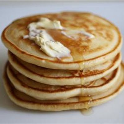 """""""Tall, fluffy pancakes are delicious served with butter and syrup or top with strawberries and whipped cream for a real treat."""""""