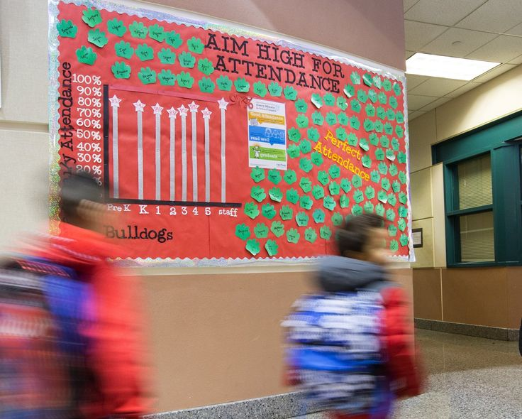 This chart in the main hallway of Manitou Park Elementary shows attendance results for each grade and the staff. (Mike Siegel/The Seattle Times)