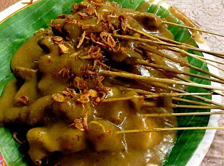 Sate Padang - skewered beef and innards with spicy curry peanut sauce from Padang, West Sumatera