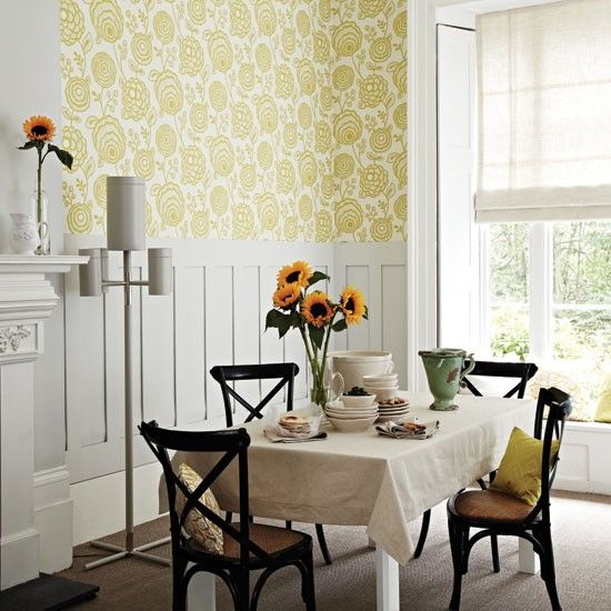 Large-scale pattern wallpaper and panelling creates a smart, balanced look. Choose bright shades to lift the scheme.