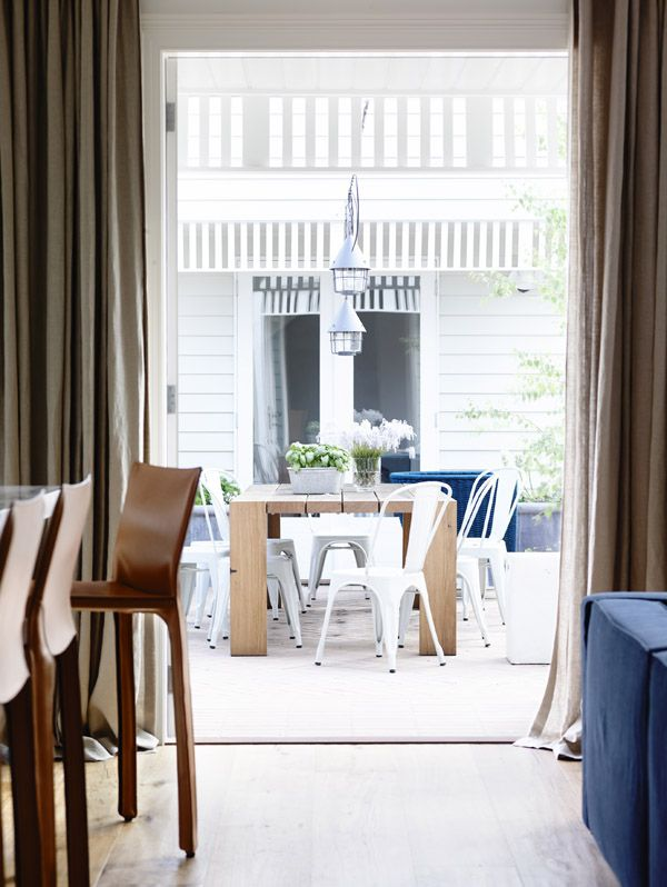 Living room / kitchen with view to outside area.  Photos - Derek Swalwell, production – Lucy Feagins / The Design Files.