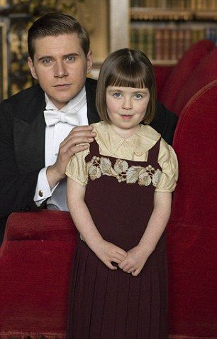 Still bereft over his wife's death, Tom Branson with daughter Sybbie