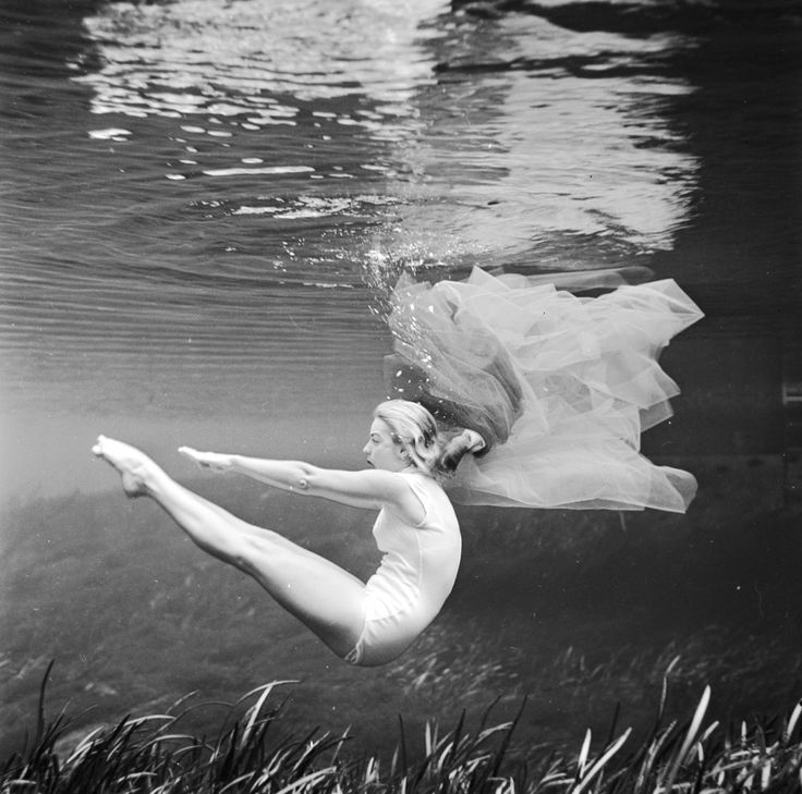 Ginger stanley strikes a balletic pose during her solo underwater ballet at silver springs florida