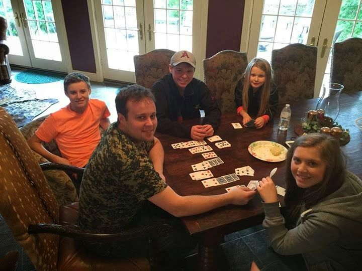 The Duggar kids playing cards.