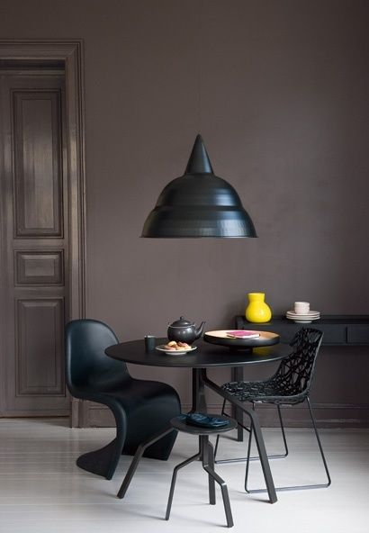 matte brown on the wall + yellow vase + black table chairs and lamp
