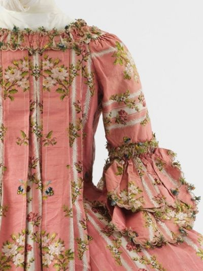 The back detail of deeply beautiful dusty rose hued Robe a'la Francaise with compere stomacher.