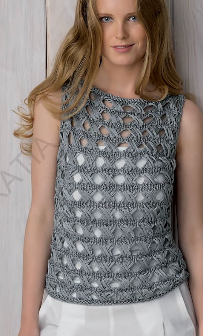 Free Knitting Pattern for Cross Over Stitch Top - Sleeveless openwork pullover knit with a 4 row repeat version of the Indian Cross stitch. Knit in 2 identical pieces and seamed. Finished bust: 36.25, 40.125, 43.25, 47.25″. Designed by Fil Katia. Bulky weight. Originally designed for a ribbon yarn. Available in English and Spanish. Note: Make sure you scroll to the end of the pattern for a correction to the stitch instructions.