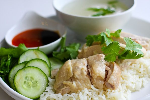 Hainanese Chicken Rice. Looks simple. Will blow your mind. Boiled chicken. Rice cooked with broth from boiled chicken.