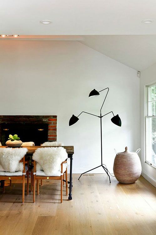 Big fireplace, Serge Mouille lamp, sheep rugs, wood, brick, plaster....what's not to love? South Hampton simplicity - desire to inspire - desiretoinspire.net