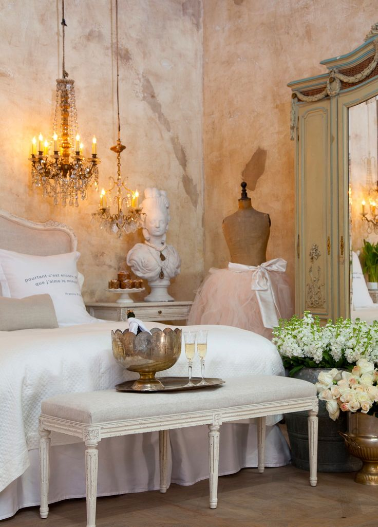 Love the walls, the chandeliers, the bench, the flowers, the dress form - terrific together. Pink & gold & French blue/green