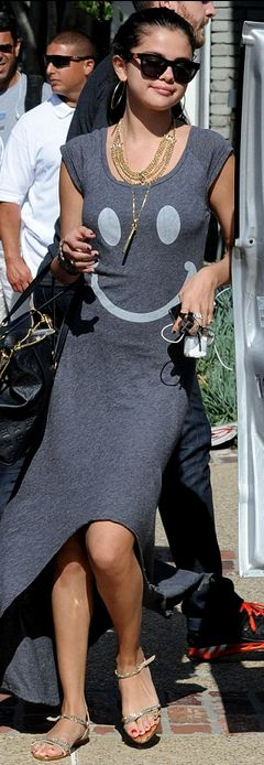Who made Selena Gomez's jewelry, smiley face maxi dress and black handbag that she wore in Malibu on May 28, 2012?