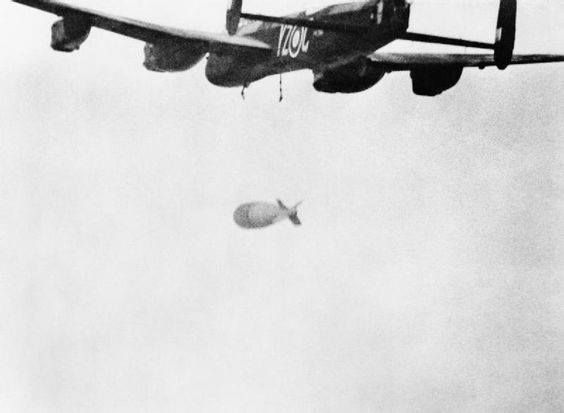 A 22000lb 'Grand Slam' falls away from an Avro Lancaster of No. 617 Squadron RAF during an attack on the viaduct at Arnsberg Germany 19 March 1945.