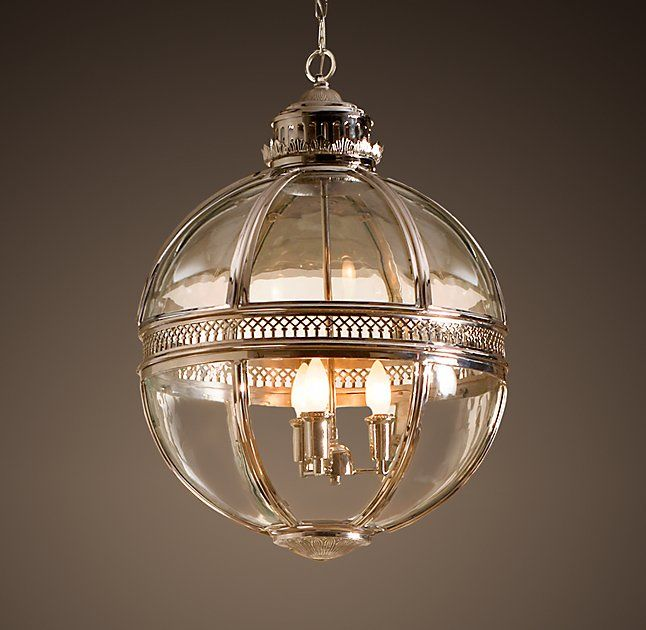 """Victorian Hotel Pendant, VICTORIAN HOTEL PENDANT $1195 - $2795REGULAR $896 - $2096MEMBER SELECT SALE ITEMS STARTING AT $855 Based on a Victorian-era fixture found in a grand European hotel, our pendant pairs the intricate open metalwork typical of flame-powered lanterns with the modern drama of an internal candelabra.  SHOW DETAILS +  DIMENSIONS Extra-Small Pendant: 12"""" diam., 18""""H; 14.7 lbs. Small Pendant: 17"""" diam., 25""""H; 25 lbs. Large Pendant: 24"""" diam., 33""""H; 59 lbs. Chain: 36""""L  $896…"""