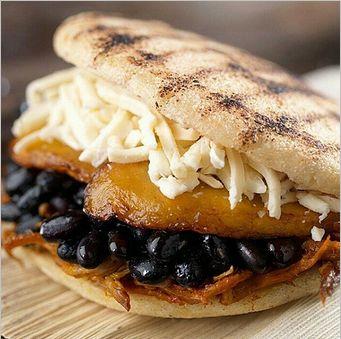 AREPA rellena con queso, platano frito maduro, frijoles negros y carne desmechada. así o mas provocativo y delicioso? Mechado Mix. Shredded Beef, Black Beans, Baked Plantains and Shredded White Cheese.
