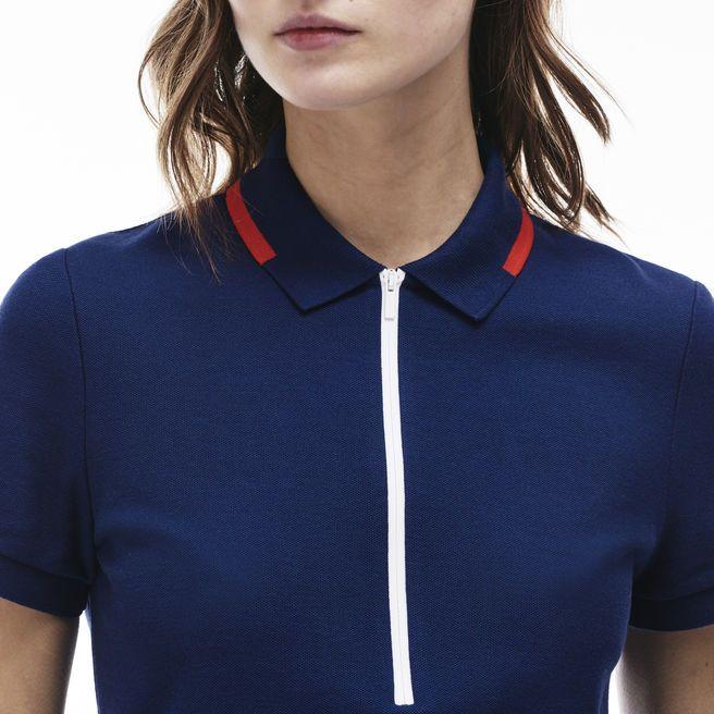 Détails contrastés, col avec piping contrasté et fermeture zippée, ce modèle Edition Made in France revisite l'iconique polo Lacoste. Une pièce chic et sportive pour toutes les femmes actives.