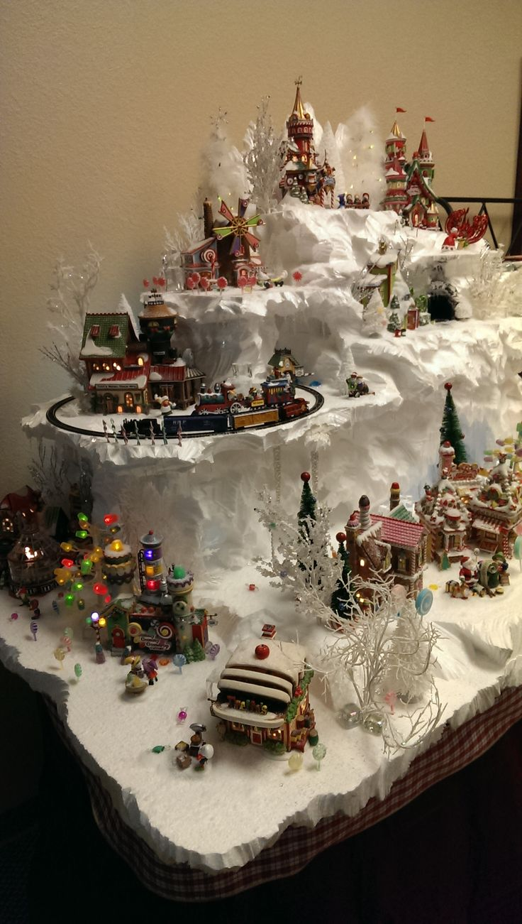 North Pole Display by Christi. I like the heights, levels if my display was against the wall. The snow cliffs are really well done.