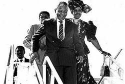 Nelson Mandela, South African freedom fighter and president of the African National Congress, and wife Winnie on their arrival at the Norman Manley International Airport, Jamaica.