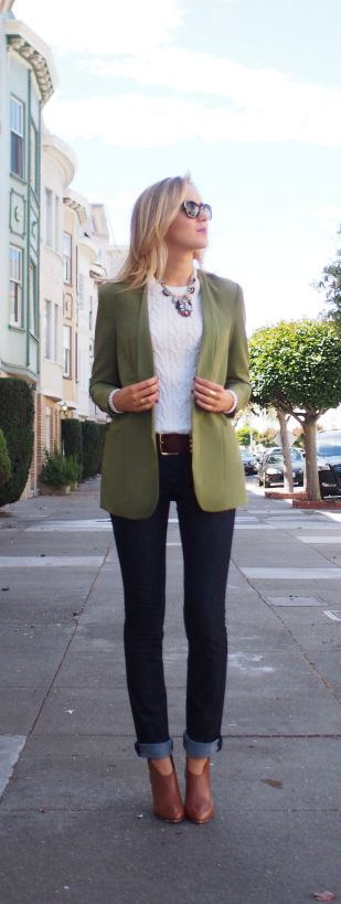 Casual outfit: blue jeans, white jumper, green blazer, brown shoes and belt and statement necklace.