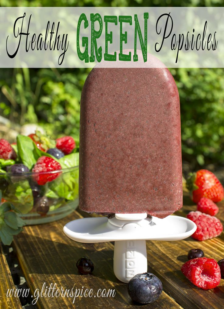 Get your kids to eat their veggies with these healthy green popsicles made with mixed berries, spinach, pomegranate juice, coconut oil and organic green powder.