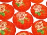 CABM088C Facet cabochon oranje rood met roos 25 mm