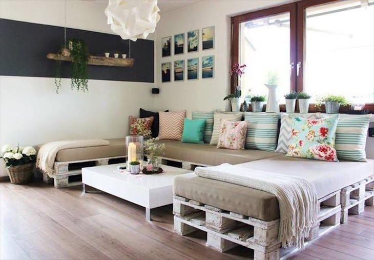 One of our favorite is this shabby and chic U-shaped pallet sofa. The white paint gives rustic look and the neutral colors are brightened up by the colorful pillows. Flower patterns or stripey ones you can go for bold and bright shades as well.