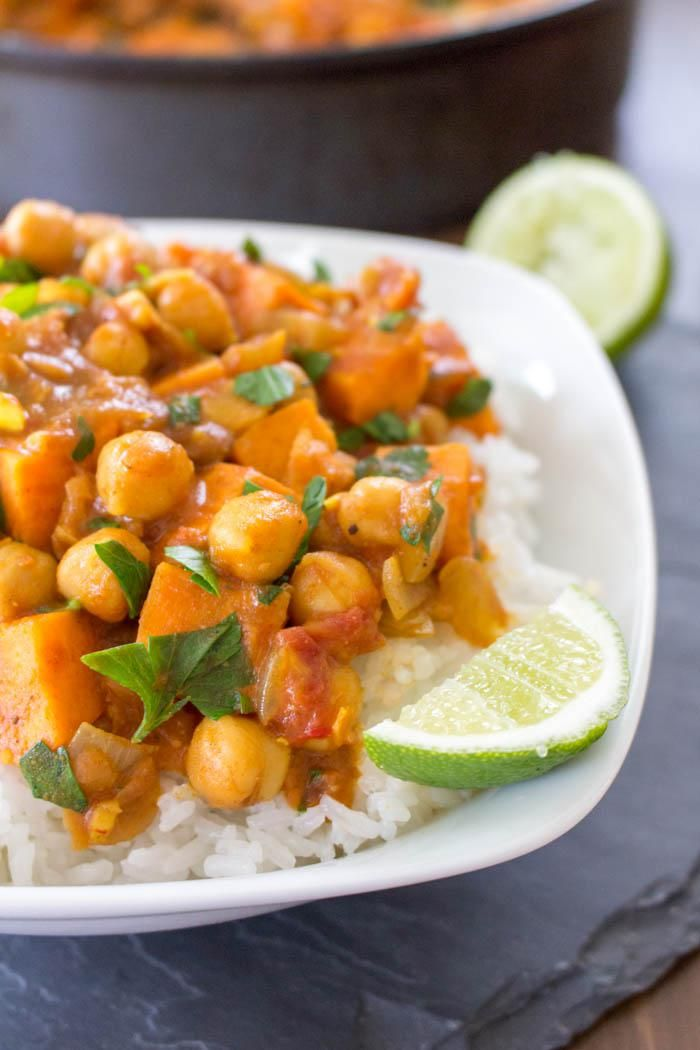 Sweet Potato Chickpea Stew -       1 small yellow onion     1 tablespoon vegetable oil     3 cloves garlic     1/2 teaspoon dried spices: cinnamon, turmeric, cumin, coriander, ground cloves     Salt, to taste     1 teaspoon fresh grated ginger      1 red chili     1 can (15 oz) diced tomatoes     1 can (15 oz) chickpeas     1 large sweet potato     1 can (15 oz) light coconut milk     1/2 cup chopped parsley     Jasmine rice, for serving