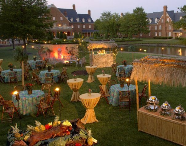 Tropical island theme. Tiki torches, huts and high top tables