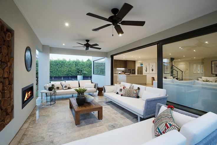 Outdoor living with a fireplace on the Charlton display home with a Caribbean World of Style