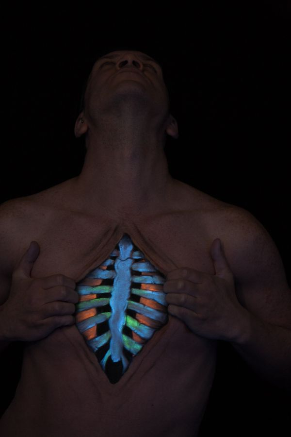 body painting of rib cage using uv paint