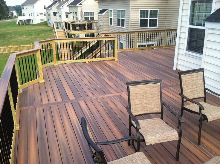 A Fiberon IPE deck with treated rails and black balusters in Martins Chase Ashburn, by Blue Moon