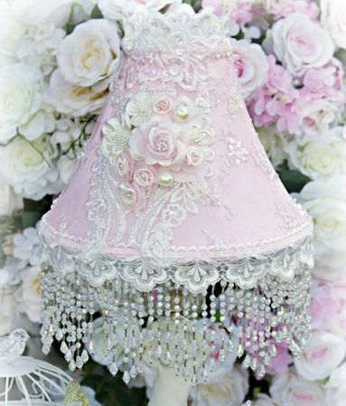 """8.5"""" tall + 5"""" fringe. The bottom opening diameter is 11"""". Incredibly feminine, our USA hand decorated lampshades feature florals, lace and beaded trims in pinks whites and ivories. Our collection als"""