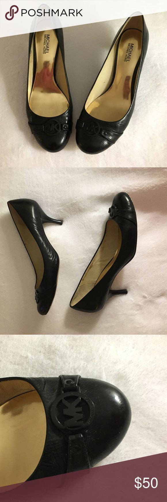 Michael Kors Black Heels Black Michael Kors Heels. Great used condition. Broken it. Signs of wear are mild. No obvious signs of wear while being worn. Great black MK logo buckle on toe. Very well made. Size 11. MICHAEL Michael Kors Shoes Heels